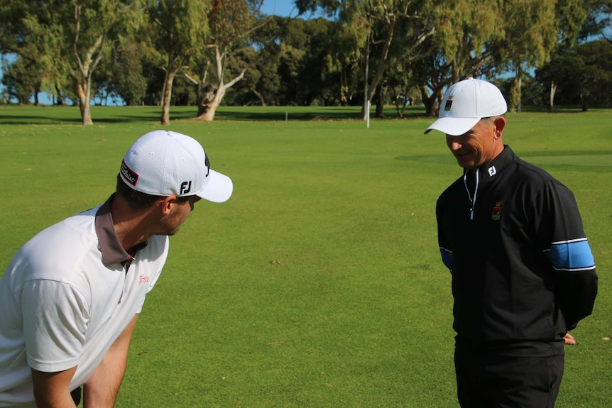 Legendary golf coach Ritchie Smith with player Jaryyd Felton.