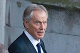 Tony Blair leaving Northern Ireland Affairs Committee hearing