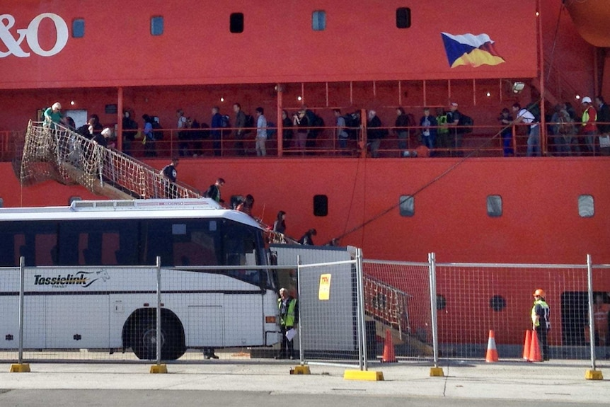 People disembark from the Aurora Australis in Hobart.