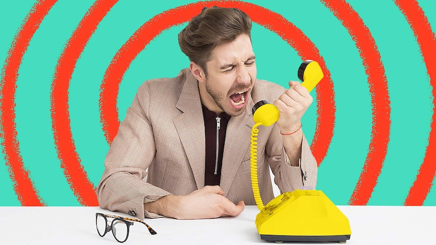 Man frustratingly yelling into yellow phone for a story about how to turn frustration into kindness