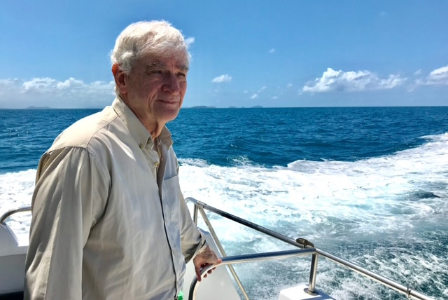 Marine researcher Eddie Hegerl looks at the ocean on a boat at Ellison Reef on the Great Barrier Reef off north Queensland.