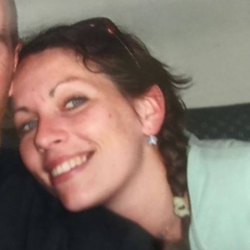 Tanya Beattie smiling and leaning in for a photo. The other person in the photograph has been cropped out.