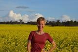 Researcher Dr Marit Kragt stands in a canola field in Western Australia's wheatbelt.