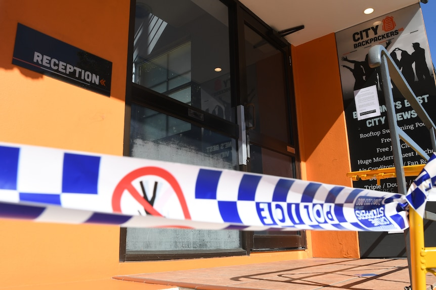 Police tape at the entry to the Roma Street City Backpackers Hostel in Brisbane