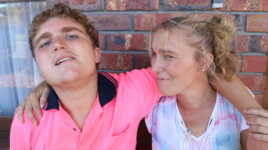 Zoe Sandell and Brodie Lunn embrace for a story about helping people with autism to sleep