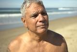 Warren Mundine shirtless at the beach