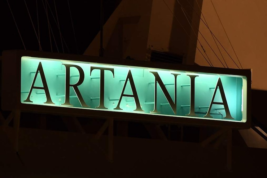 A close-up shot of the Artania sign on the cruise ship docked at Fremantle Port before dawn.