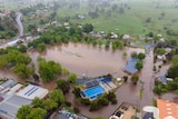 An aerial view of a flooded oval.