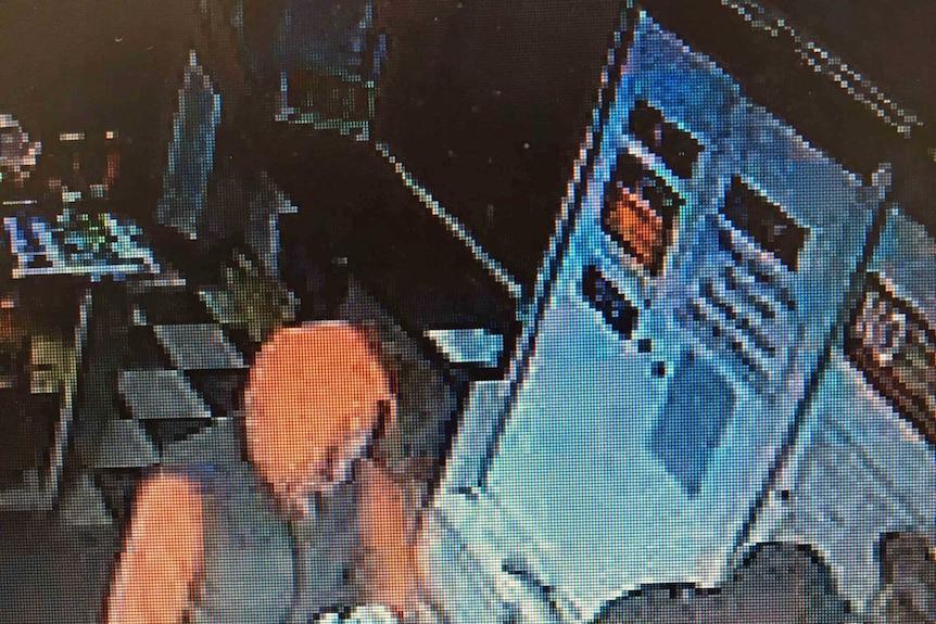 Robbery in progress in Hobart shop
