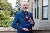 Tasmanian Australian of the year 2018, Scott Rankin with his award at Government House November 2017