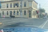 A deer seen running on a street in Fitzroy from inside a car.