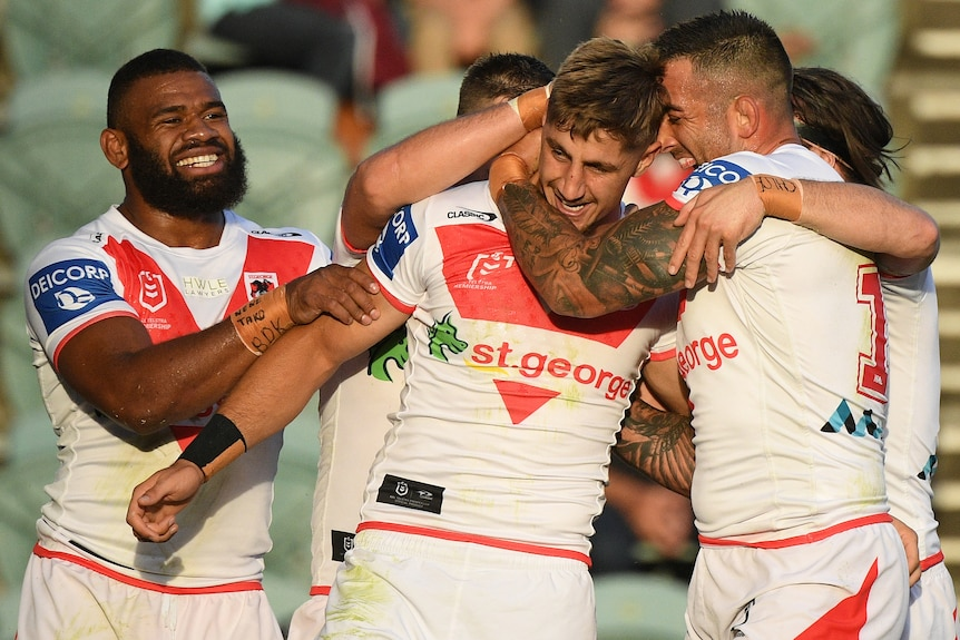 Dragons celebrate a try against the Sea Eagles
