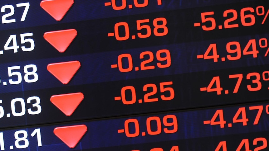 Information screens at the ASX show losses after the market opened