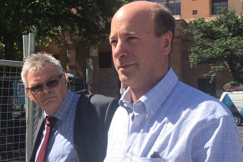 Peter Seppelt leaves court in Adelaide with his lawyer.