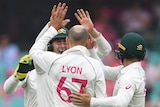 Nathan Lyon raises his hand to high-five Marnus Labuschagne