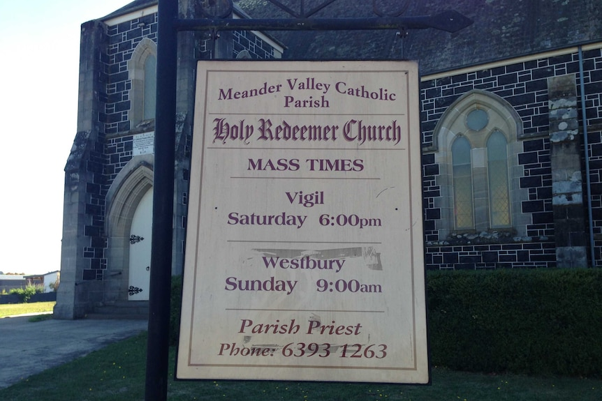 The sign out the front of the Holy Redeemer Church in Deloraine, Tasmania.
