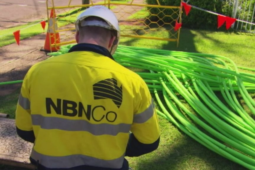 A NBN Co worker at work with cables.