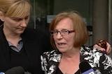 Alma Krecu and Rina Serpo speak to the media.