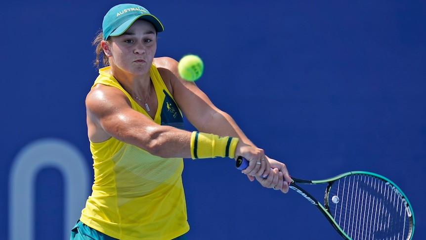 An Australian female tennis player prepares to play a backhand at the Tokyo Olympics.