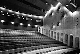 A black and white photo of the inside of a theatre.