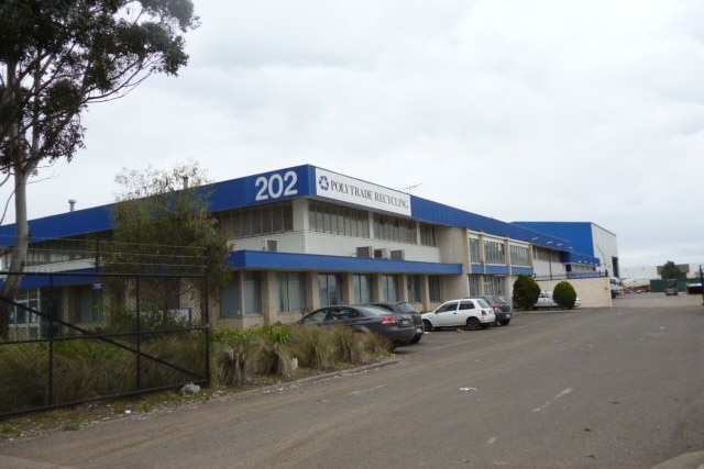 A building with the words Polytrade Recycling Centre on the front