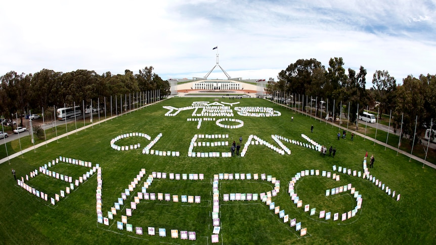 Placards on the lawn in front of Parliament House