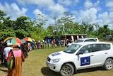 Voters queue at a polling station in Vanuatu