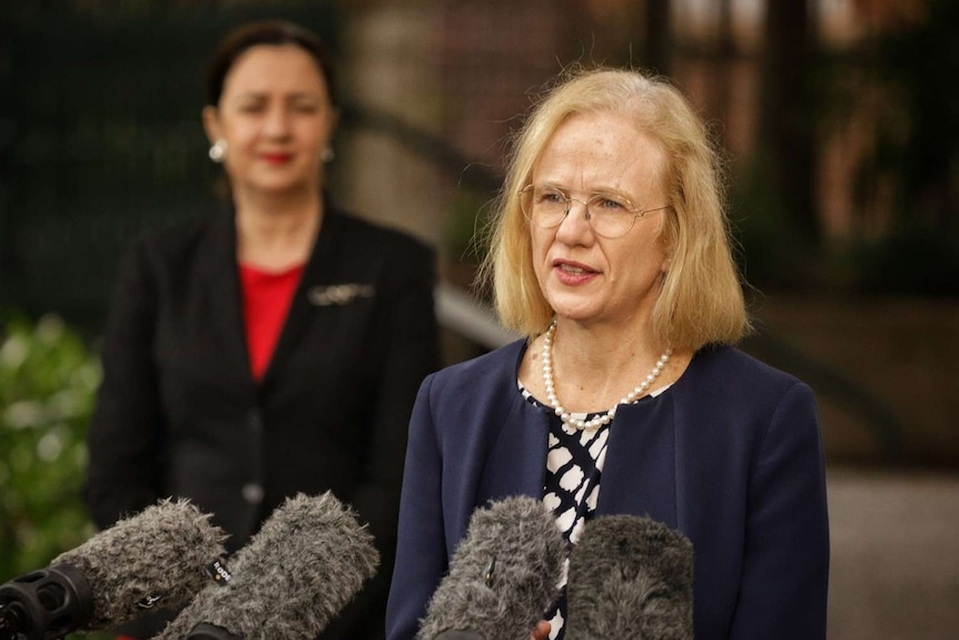 Dr Jeannette Young speaks at a media conference with Annastacia Palaszczuk looking on in the background.
