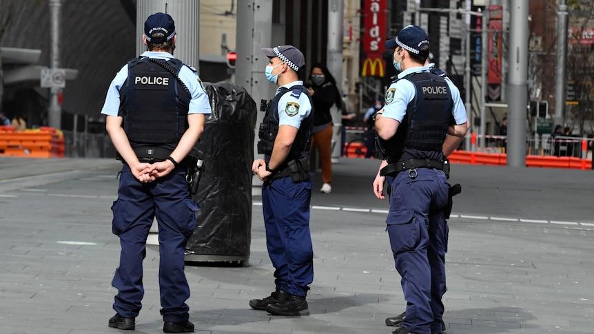 police standing around on a sydney street