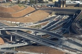 An aerial view of a work site including a spaghetti junction of roads.