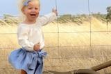Brown snake photobombs snap of toddler