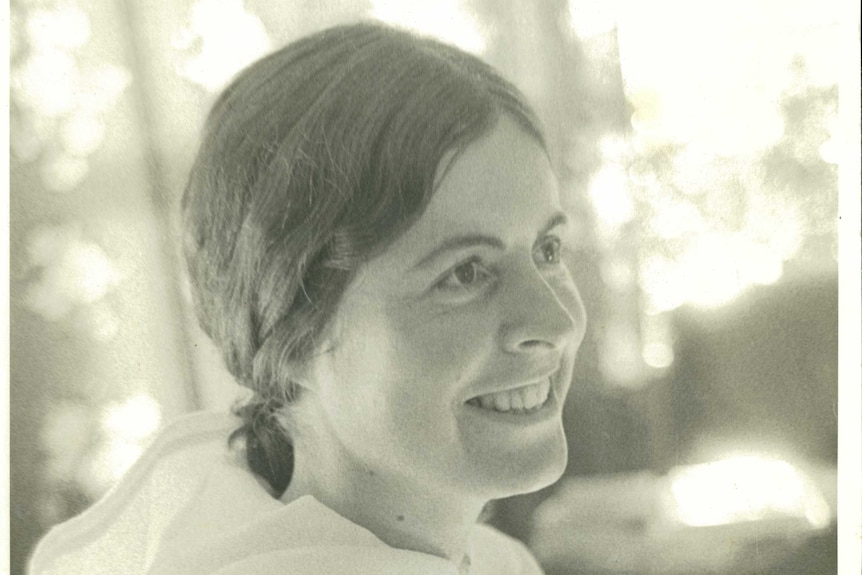 A black and white photo of a smiling Mary Garden on the day she left for India, in April 1973.