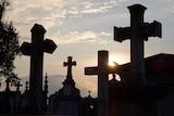 Silhouetted gravestones