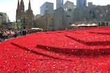 Hand-made poppies placed around Federation Square
