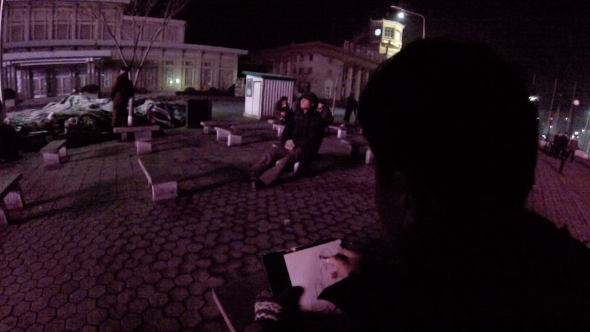 North Korean artists sketch each other and passers by in downtown Pyongyang.