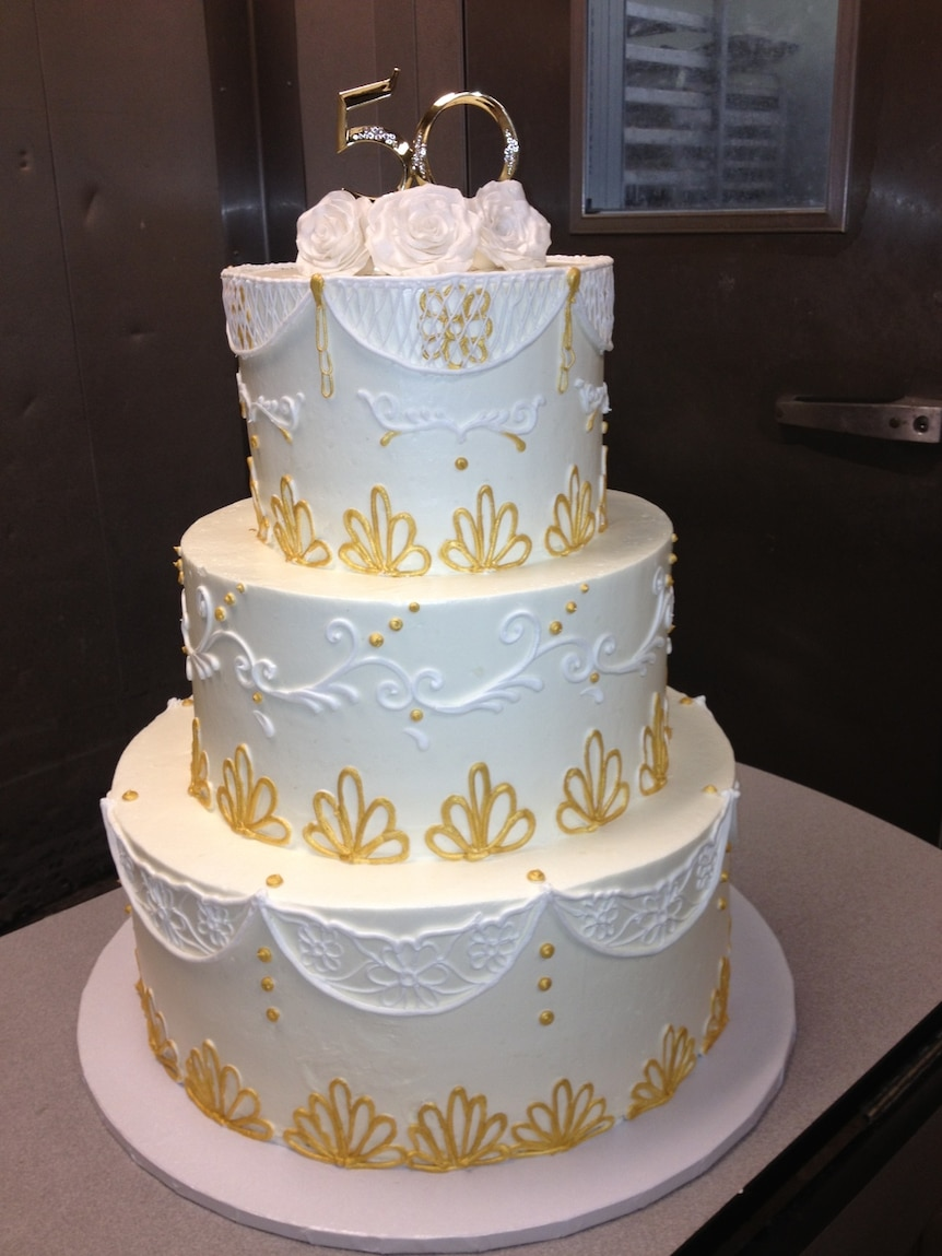 A cake adorned with gold.
