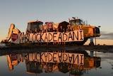 A sign saying Blockade Adani