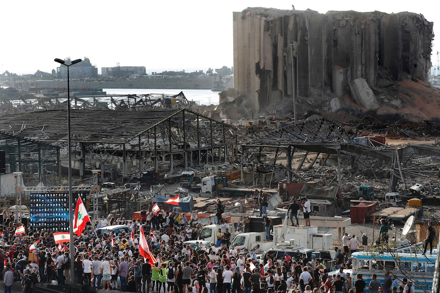 People gather in honour of the victims at the scene of last week's explosion in Beirut.