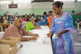 Woman stands at a polling station