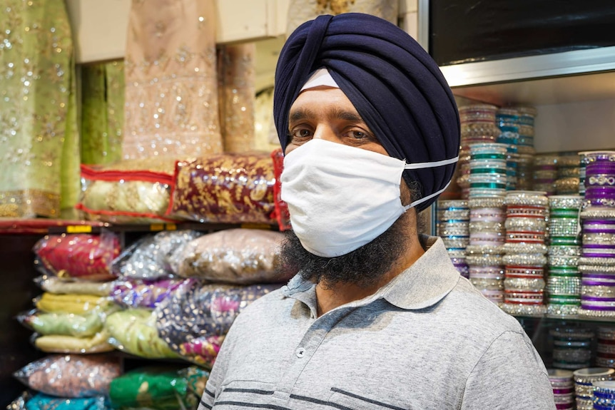 Harpreet Singh wears a facemask with longer elastic straps and a larger pouch.