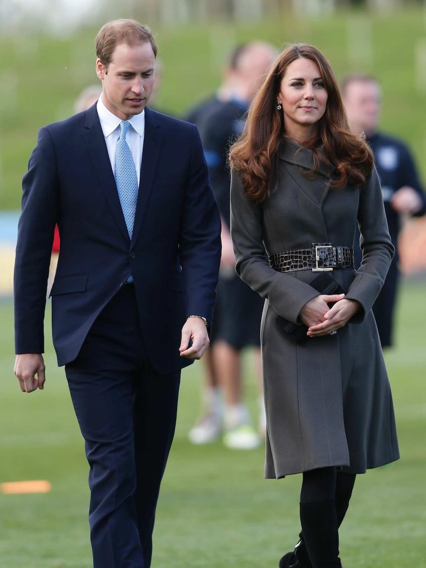Britain's Prince William walks alongside his wife Catherine, Duchess of Cambridge.