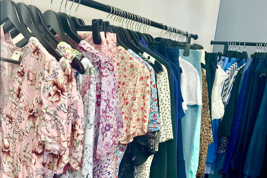 Dresses, pants and a range of clothes on racks