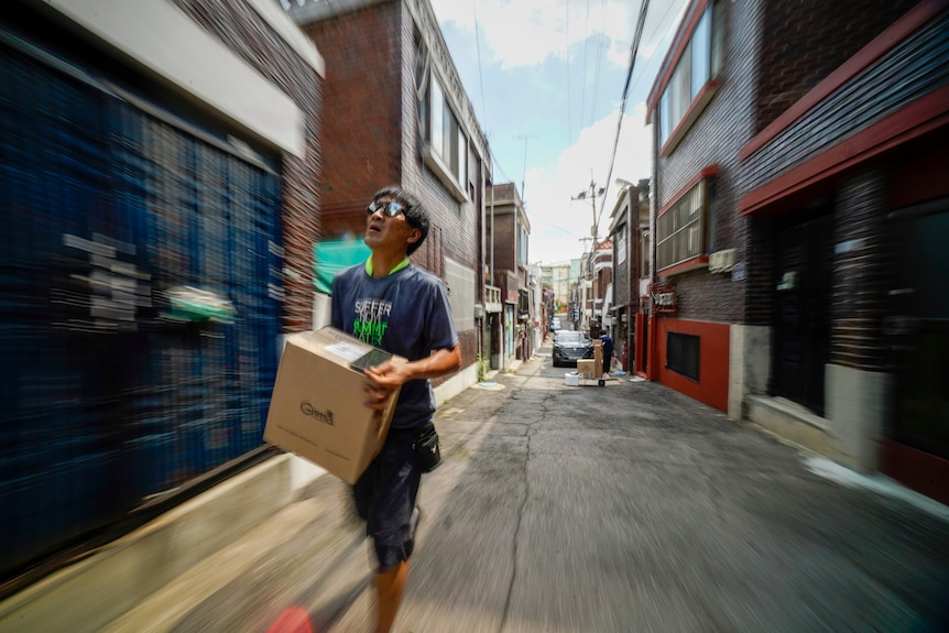 A man with a box.