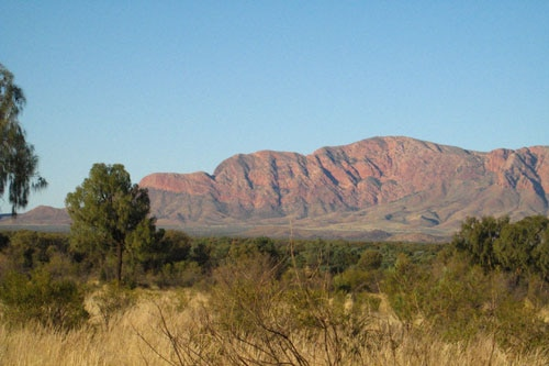 The remote community of Haasts Bluff - hill by main road