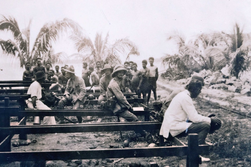 Group of men and local people