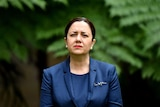 Annastacia Palaszczuk with a serious expression in a suit at parliament