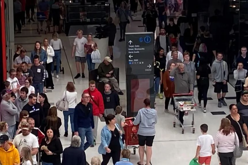 Crowds make their way through a shopping centre at close distance