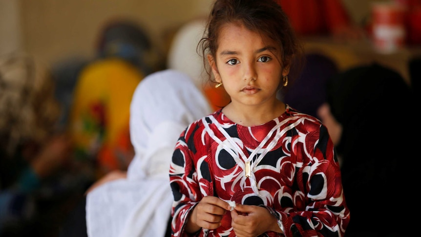 A young Iraqi girl looking solemn