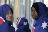 Young Muslim women modelling Australian flag hijabs.