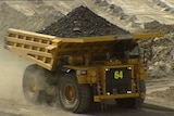 A mining truck carries coal in a Queensland mine.